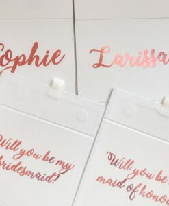 bridesmaid and maid of honour boxes with pink writing