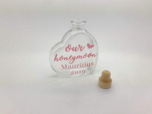 honeymoon sand heart with dates on