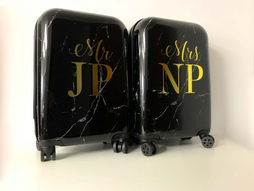 black marble effect suitcase with gold initials