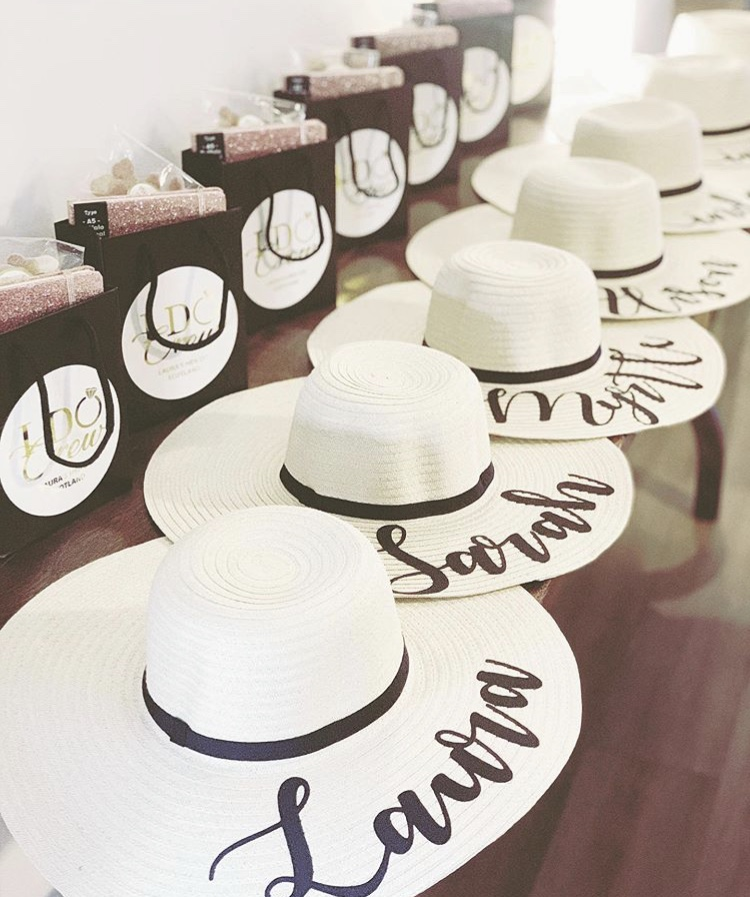 personalised hats for hen do with names and ribbon