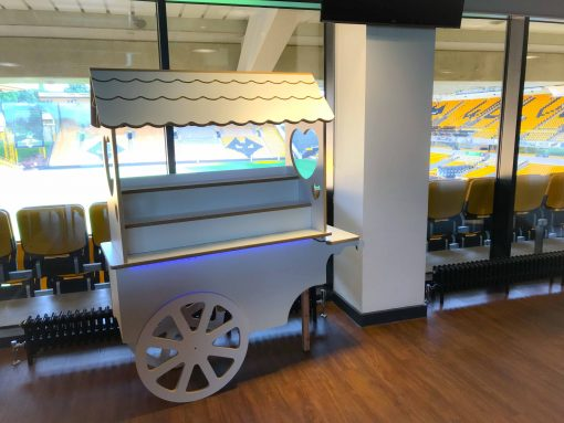 white sweet cart to hire for wedding day