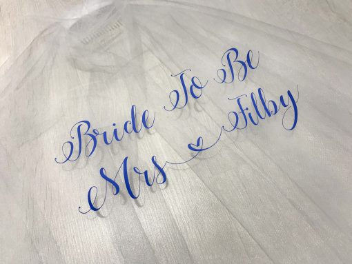 bride to be veil with blue text