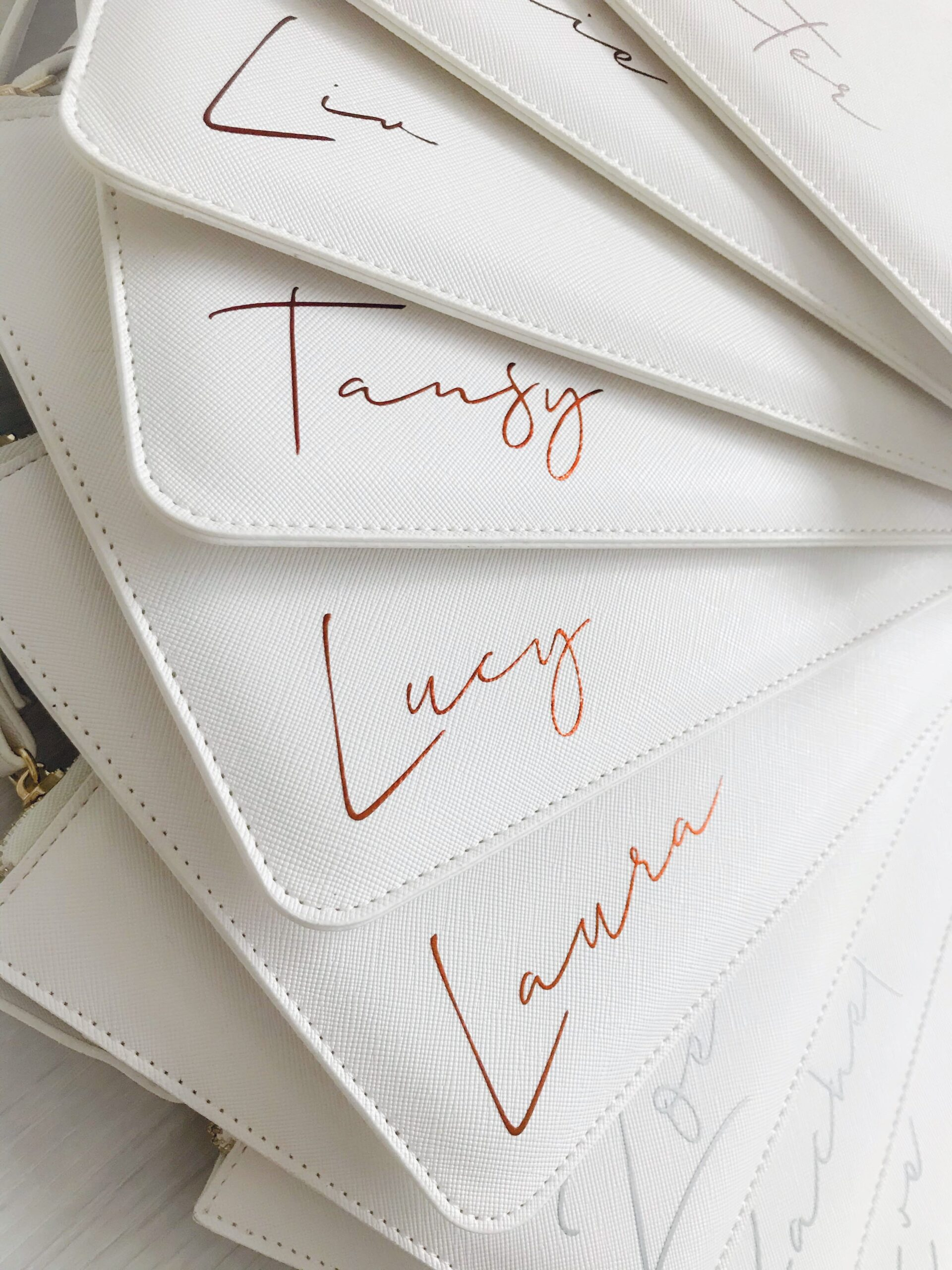 personalised white leather look clutch bag
