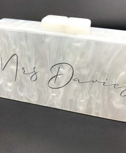 mother of pearl clutch bag with text